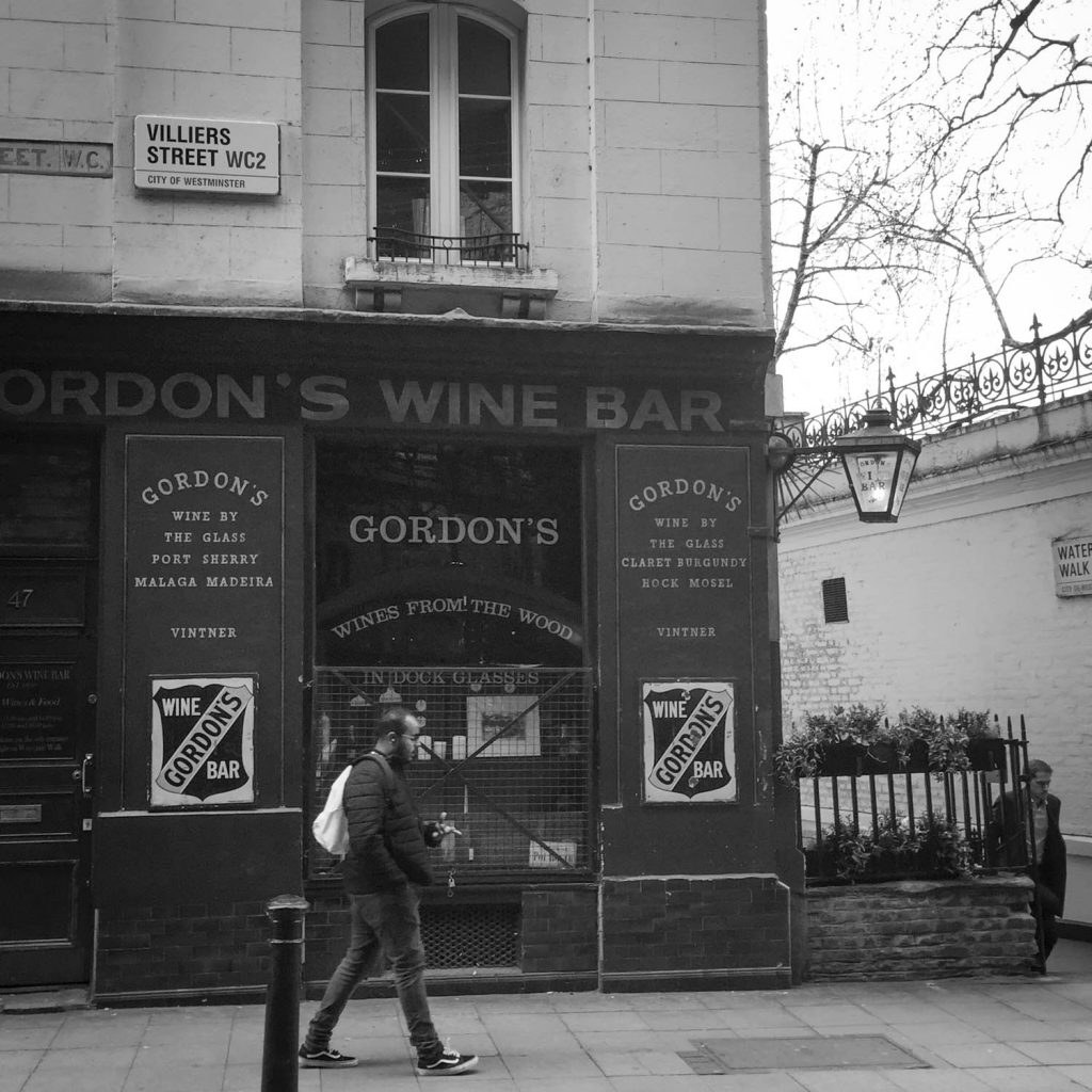 Black and white photo of Gordon's Wine Bar on Villiers Street near Embankment Station, London - Photo by illustrator Jonathan Chapman