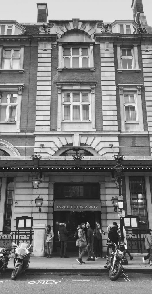 Black and white photo taken outside the Balthazar Restaurant in Covent Garden, London -  Photo by Illustrator Jonathan Chapman