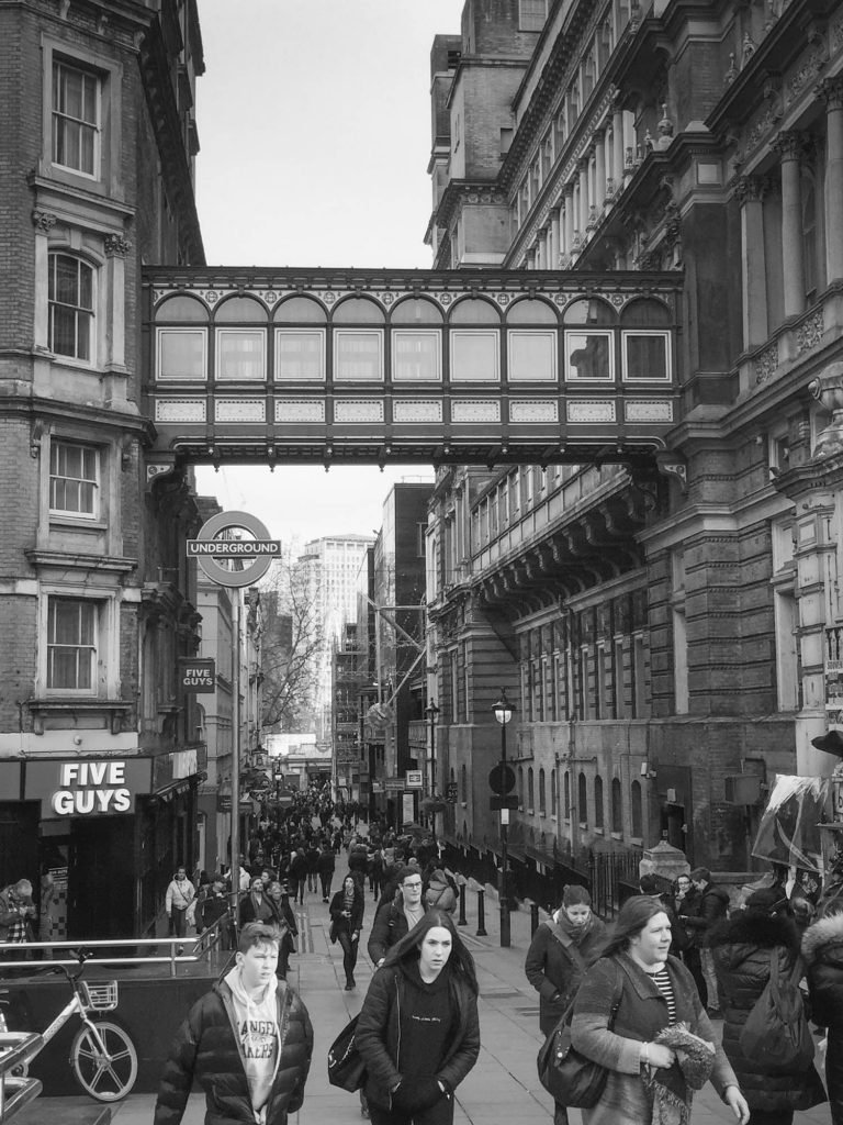 Black and white photo of the view along Villiers Street at Charing Cross, London - Photo by illustrator Jonathan Chapman
