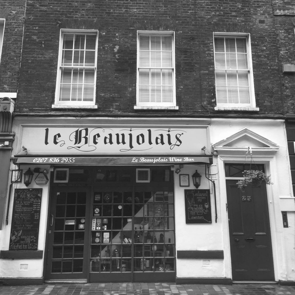 Black and white photo taken outside of Le Beaujolais Restaurant in Covent Garden, London - Photo taken by Illustrator Jonathan Chapman