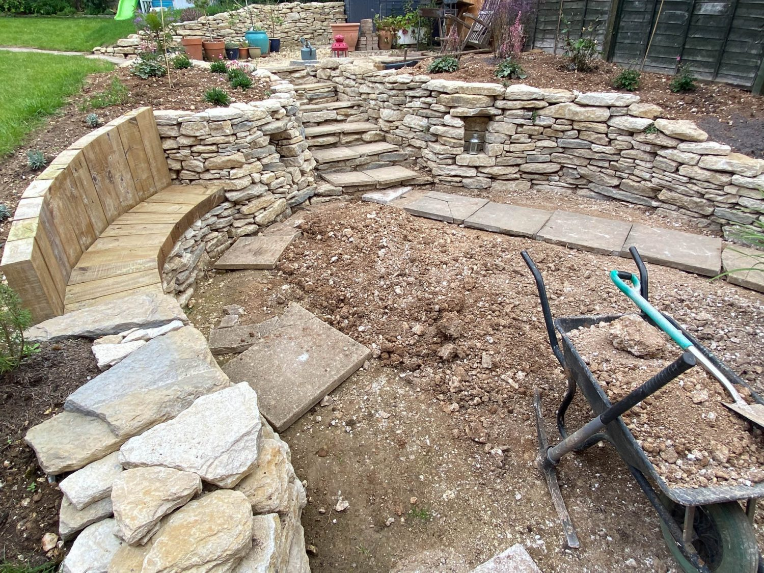 Landscaping the garden, with new patio area and path
